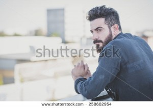 stock-photo-young-handsome-attractive-bearded-model-man-in-urban-context-258602954