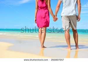 stock-photo-beach-couple-in-love-holding-hands-on-honeymoon-lower-body-crop-showing-pink-dress-casual-260807057