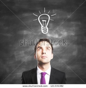 stock-photo-businessman-with-lamp-idea-concept-121335382