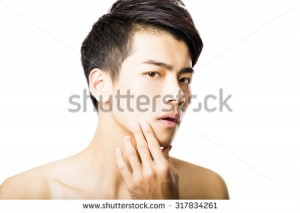 stock-photo-closeup-portrait-of-attractive-young-man-face-317834261