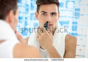 stock-photo-handsome-young-man-remove-hair-from-his-nose-with-trimmer-156070652