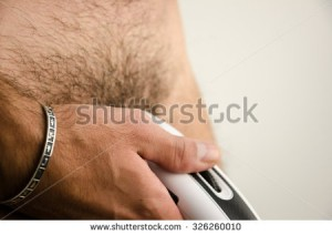 stock-photo-man-haircut-pubic-hair-with-a-clipper-326260010