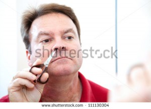 stock-photo-middle-aged-man-trimming-his-nose-hair-with-grooming-scissors-111130304