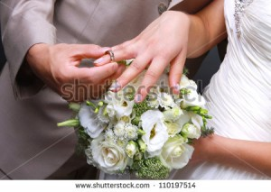 stock-photo-he-put-the-wedding-ring-on-her-110197514